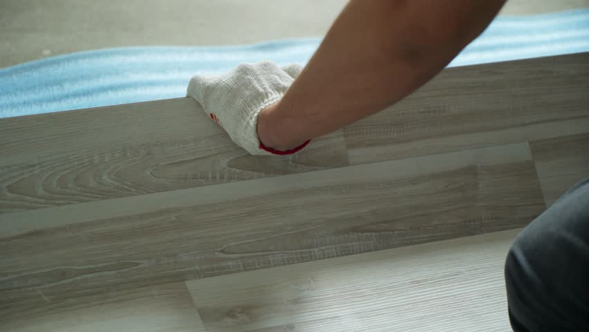 Builder renovating apartment. Repair of the apartment, laying laminate flooring. Construction. | Shutterstock HD Video #1025655926