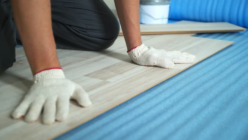 Builder renovating apartment. Repair of the apartment, laying laminate flooring. Construction. | Shutterstock HD Video #1025655935
