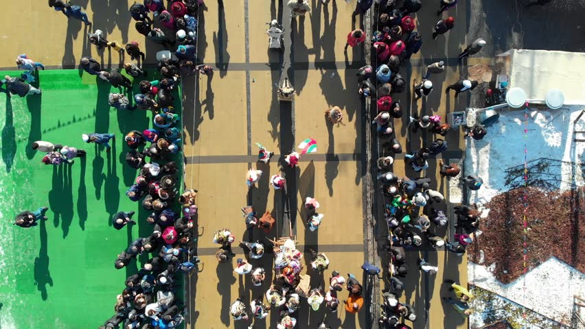 BULGARIA - JANUARY 27, 2019 - Aerial view of Surva masquerade festival street in Pernik, Bulgaria. Kukeri - people dressed in costumes and masks dance to scare the evil spirits. #1025674712