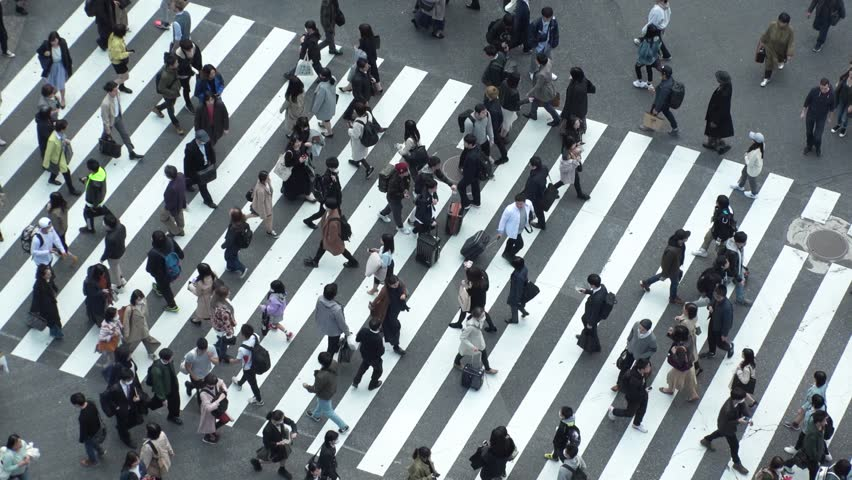 SHIBUYA,  TOKYO,  JAPAN - CIRCA MARCH 2019 : Aerial view around SHIBUYA scramble crossing.  Close up shot of pedestrians crossing.  Slow motion shot. | Shutterstock HD Video #1025676482