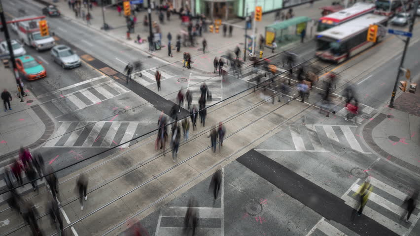 Toronto, Canada, time lapse view of traffic and pedestrians crossing busy intersection at Yonge and Dundas Square in downtown Toronto.  Royalty-Free Stock Footage #1025696258