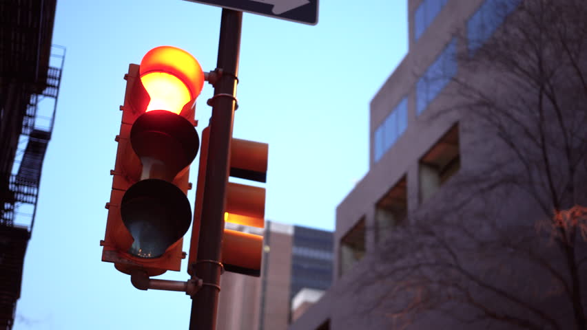 Close up of a traffic light in the city