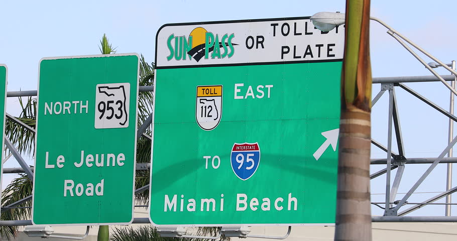 Miami, Florida / USA, February 24, 2019: Road Street Highway Green Signs In Florida With Text For Interstate 95 To Miami Beach And North 953 Le Jeune Road, Sunpass Toll Or Toll By Plate - DCi 4K