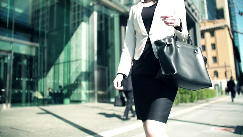 Walking Japanese business woman in Tokyo Japan | Shutterstock HD Video #1025705480