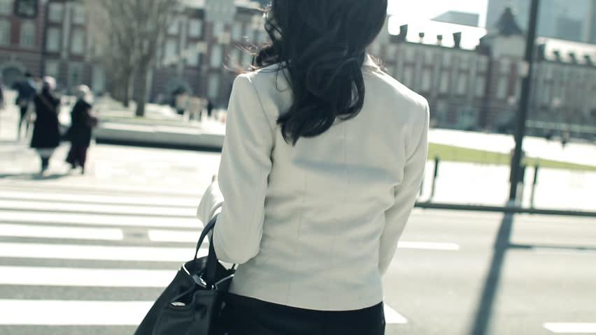 Walking Japanese business woman in Tokyo Japan | Shutterstock HD Video #1025705516