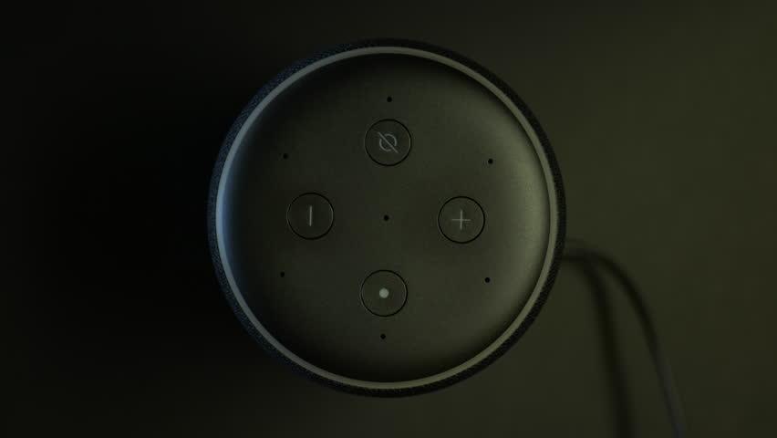 Locust Grove, United States - 01 10 2019: Amazon Echo Smart Home Device, Alexa Answers Question. Circa January 2019