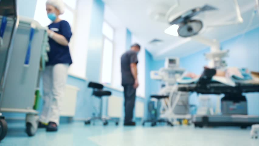 View of the operating room. A surgical medical team working in the modern operating room of the hospital was preparing the operating room for the operation. blur effect, blur video. | Shutterstock HD Video #1025716661