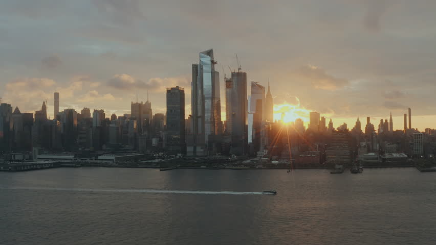Aerial View Sunrise at New York City and sunflares 4k Royalty-Free Stock Footage #1025739158