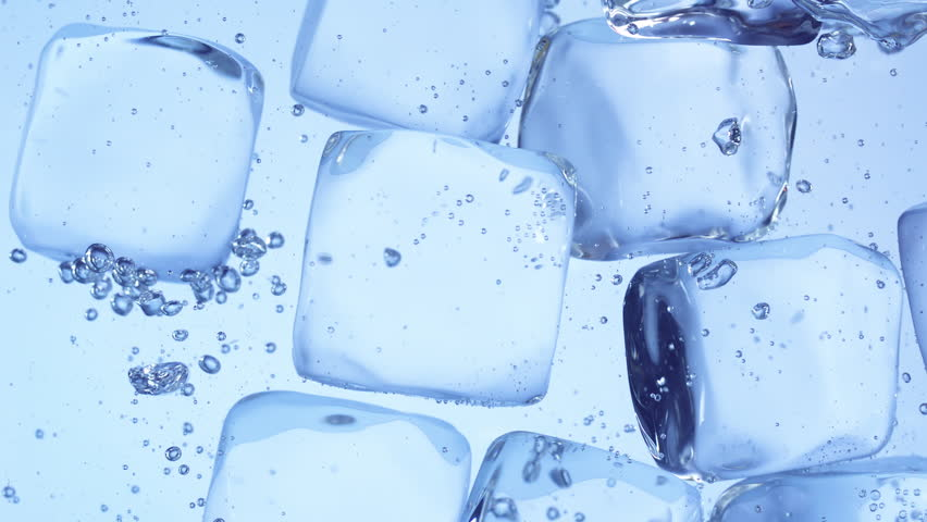 Close up slow motion movement of stacked ice cubes under water