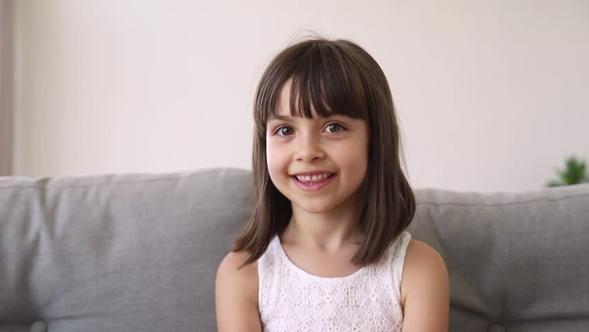 Funny little girl vlogger blogger looking at camera talking recording vlog, cute preschool pretty kid speaking to webcam making online video call having fun waving hand blowing kisses Royalty-Free Stock Footage #1025766242