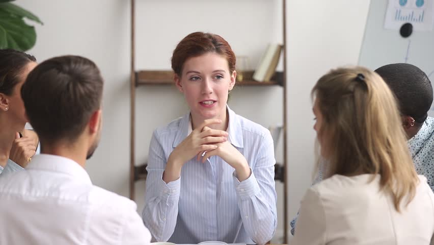 Female teacher coach mentor leader speaking teaching diverse staff students interns at group office meeting, executive manager speaker training employees consulting clients at team corporate workshop Royalty-Free Stock Footage #1025766332
