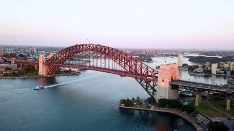 4k aerial cinematic drone footage b-roll of Sydney Harbour Bridge during sunrise.