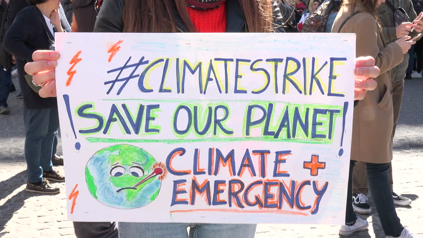 "MILAN, ITALY - MARCH 15, 2019:  Colorful picket sign for global strike for climate. Friday for future, Greta Thunberg ecological movement, placard of activism ""SAVE OUR PLANET CLIMATE EMERGENCY"""