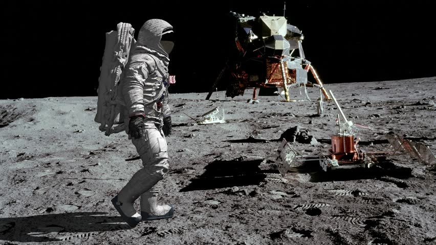 Astronaut walking on the moon. Royalty-Free Stock Footage #1025816600