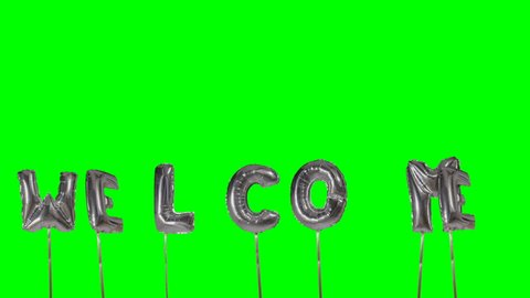Word welcome from helium silver balloon letters floating on green screen