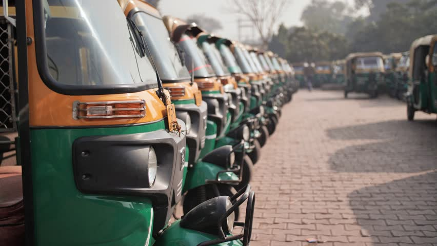 Indian taxi rickshaws exposed in a row.   Shutterstock HD Video #1025891612