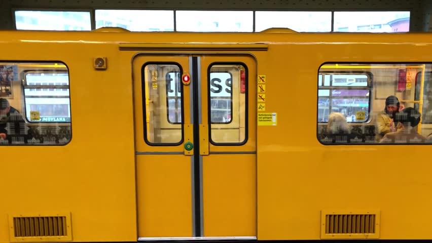 Berlin, Germany - march, 2019: Metro / subway train leaving train station (Kottbusser Tor) in Berlin, Kreuzberg