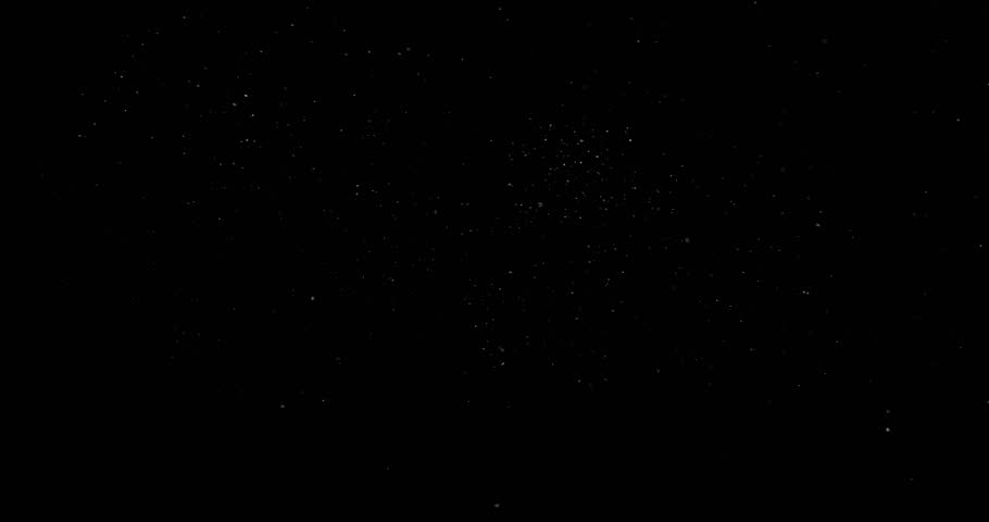 Flying dust particles on a black background #1025944877