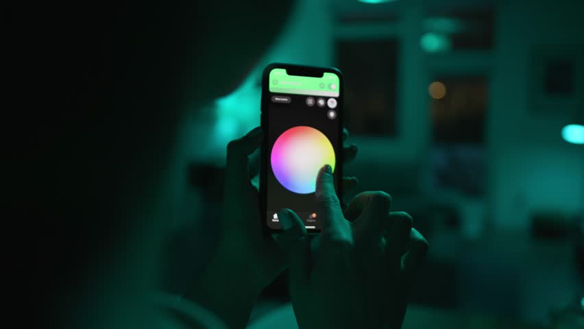 Controlling lights with an app in smart home / Smart house features / Changing mood/color of the lights    Shutterstock HD Video #1025962763