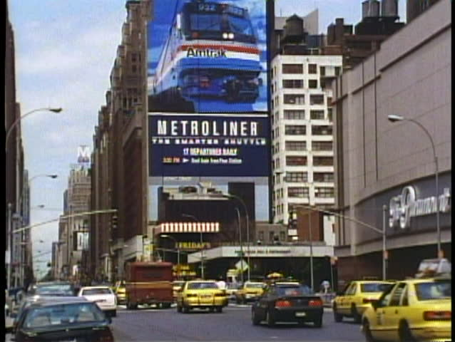 NEW YORK CITY, 1994, Eighth Avenue, busy, taxis, big Metroliner sign
