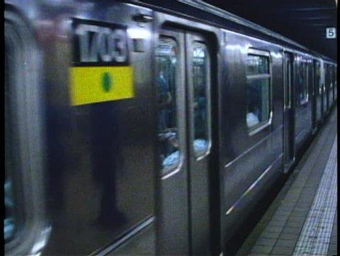NEW YORK CITY, 1994, Subway train leaves Lexington Avenue station