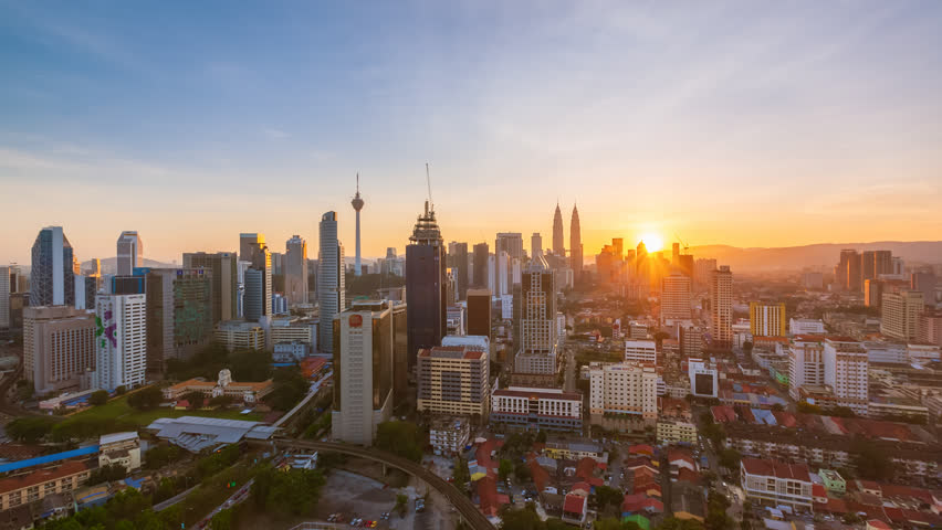 Time lapse: Kuala Lumpur city view during dawn overlooking the city skyline in Federal Territory, Malaysia.
