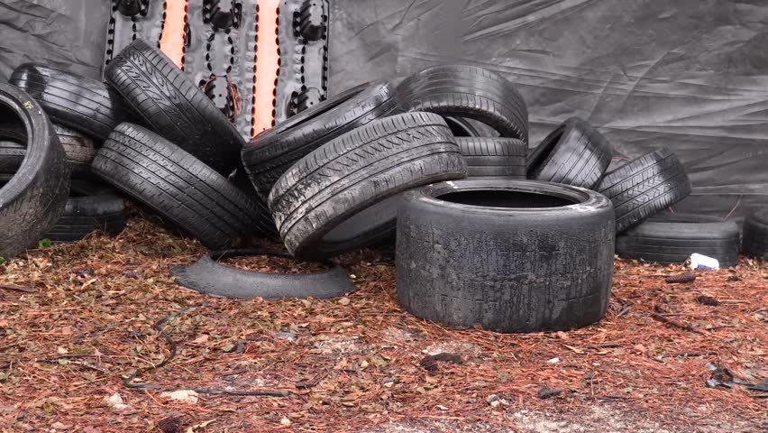 Used Tires being Thrown on a Huge Scrap Pile of Junk Tires. | Shutterstock HD Video #1026016658