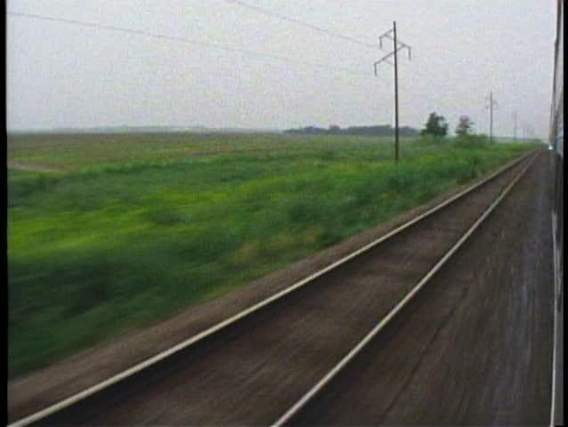 CENTRAL IOWA, 1994, POV out train window, passing prairies, California Zephyr