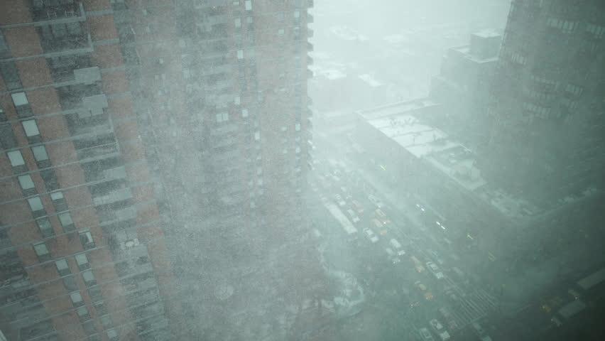 Heavy winter snow storm blizzard on NYC Manhattan street corner looking down at traffic.mov