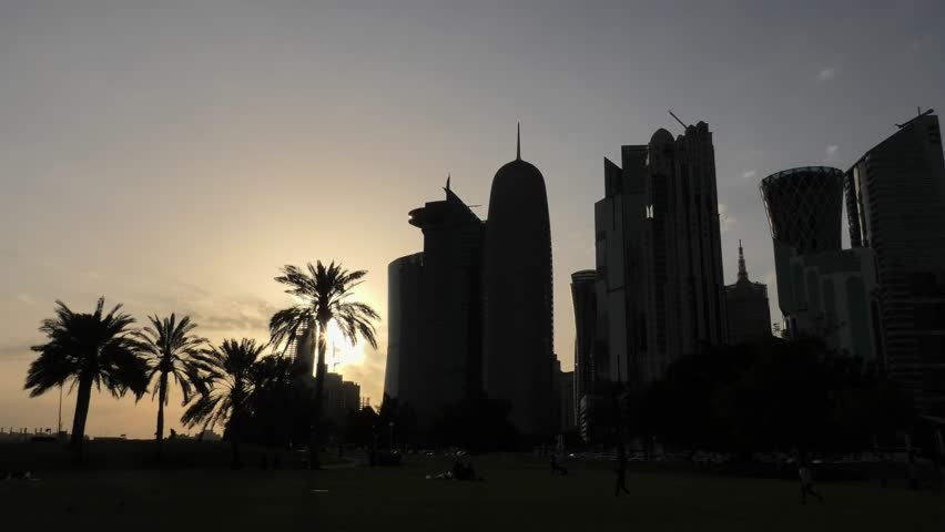 Scenic Doha West Bay high rises at sunset light reflecting in the water of park in Downtown. Modern skyscrapers of Doha skyline in Qatar, Middle East, Arabian Peninsula in Persian Gulf. | Shutterstock HD Video #1026075806