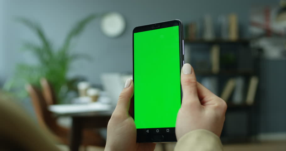 Caucasian female hands holding black smartphone with chroma key screen in the cozy modern office. Close up. | Shutterstock HD Video #1026076754