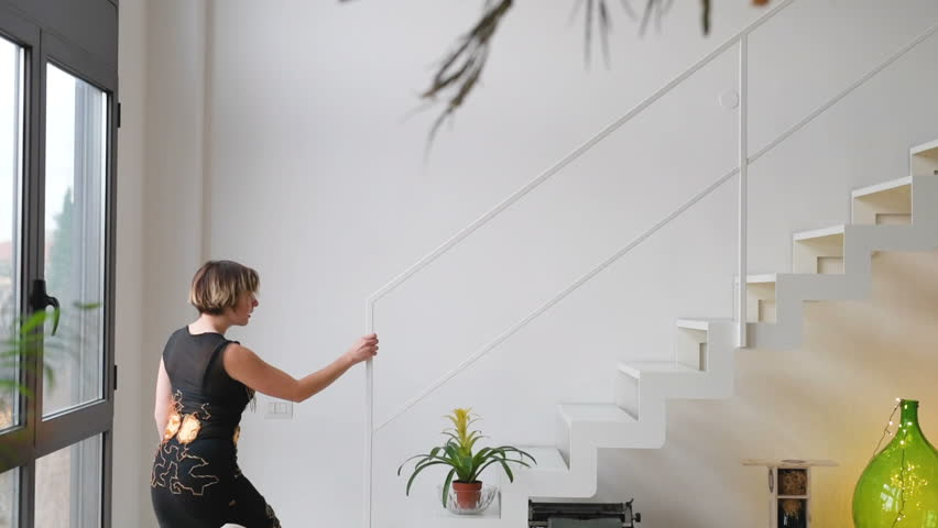 adult woman indoor running upstairs – hurry, moving concept #1026097412