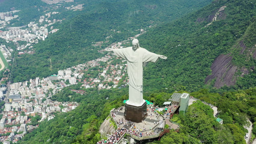 RIO DE JANEIRO, BRAZIL - CIRCA 2016: Aerial view of Christ the Redeemer (monumental statue of Jesus Christ) on top of Corcovado mountain, cityscape of Rio de Janeiro in background.