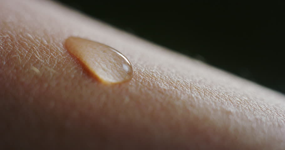 Slow motion macro of fresh cleansing water drop falling on an young smooth healthy human skin. Shot in 8K | Shutterstock HD Video #1026098909