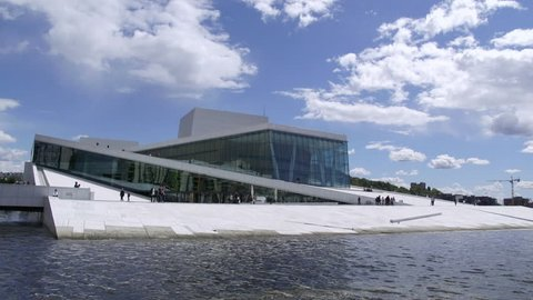 OPERA HOUSE OSLO NORWAY - MAY 26, 2015: Distant time lapse view of the famous opera house in Oslo Norway