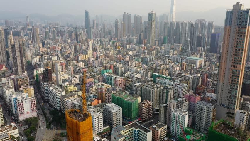 Sham Shui po, Hong Kong 19 March 2019: Top view of Hong Kong city at sunset time | Shutterstock HD Video #1026111716