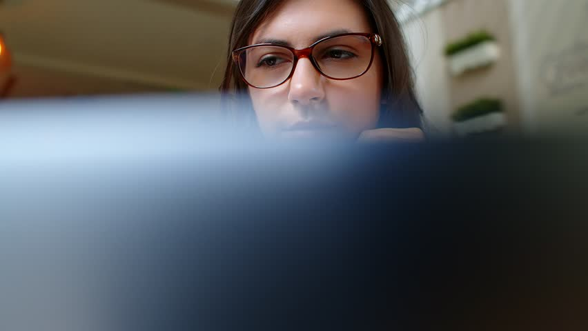 Beautiful Young Successful Business Woman Working On Laptop In Cafe, pov, 4k slow motion | Shutterstock HD Video #1026115700