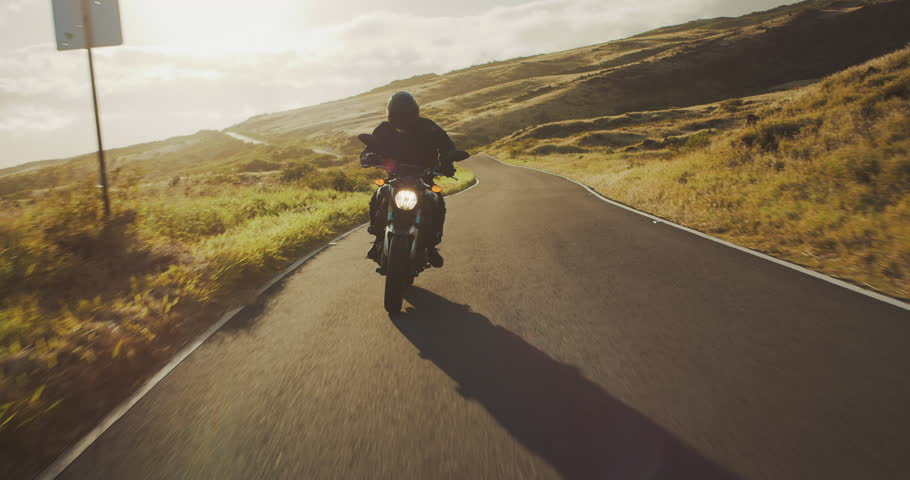Motorcyclist riding fast at sunset on country road, motorcycle adventure lifestyle | Shutterstock HD Video #1026135194