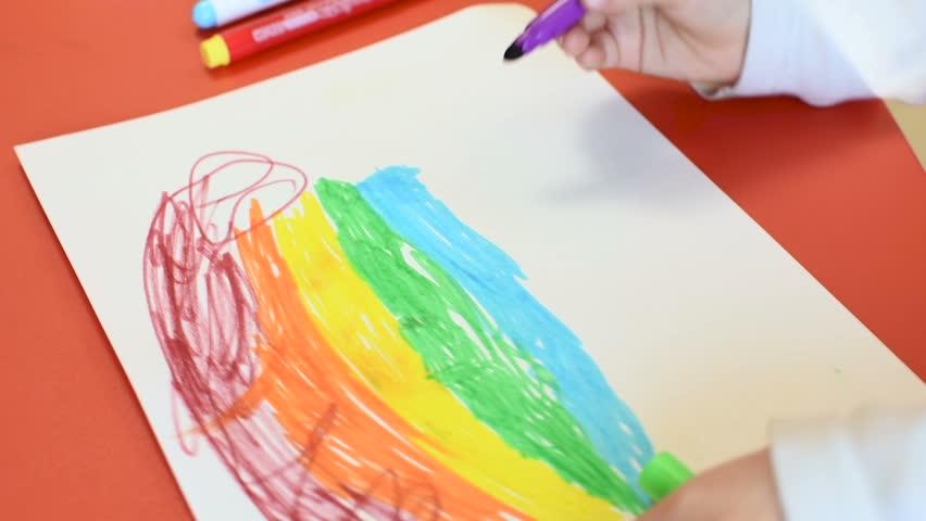 Rainbow on a sheet of paper. Little girl drawing a rainbow on a white sheet of paper with felt-tip pens. | Shutterstock HD Video #1026163604