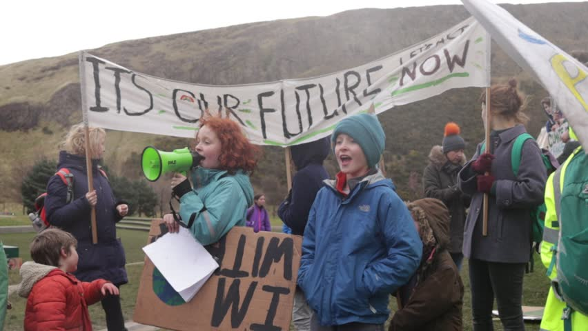 "Edinburgh, Scotland - March 15 2019: Fridays for the future, Children Chanting ""Hey ho - Climate change has got to go"""
