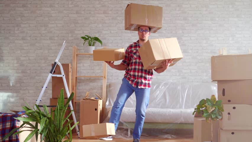 Man in glasses and shirt with boxes on his head, hands and feet   Shutterstock HD Video #1026227363