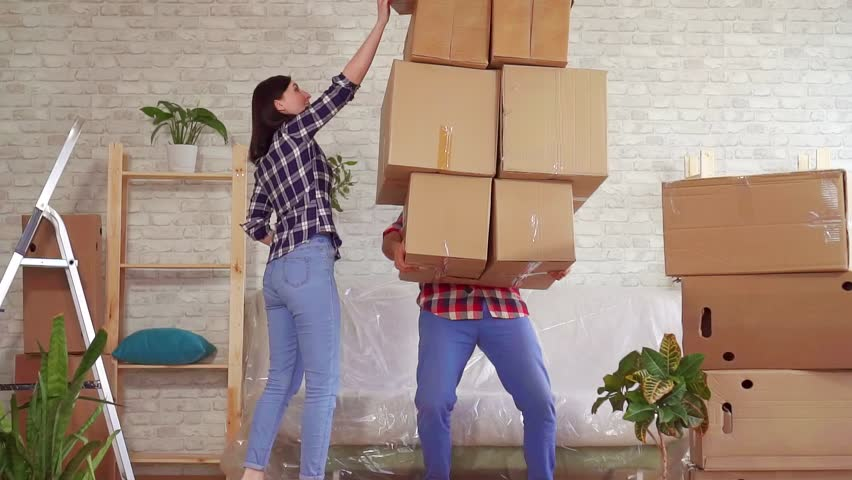 Fale man falls with boxes, problems when moving to a new apartment slow mo   Shutterstock HD Video #1026227366