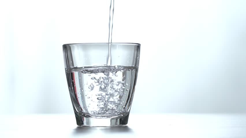 Pouring fresh pure water from bottle into a glass on the table, health and diet concept, Isolate on white background, Slow motion footage | Shutterstock HD Video #1026238937
