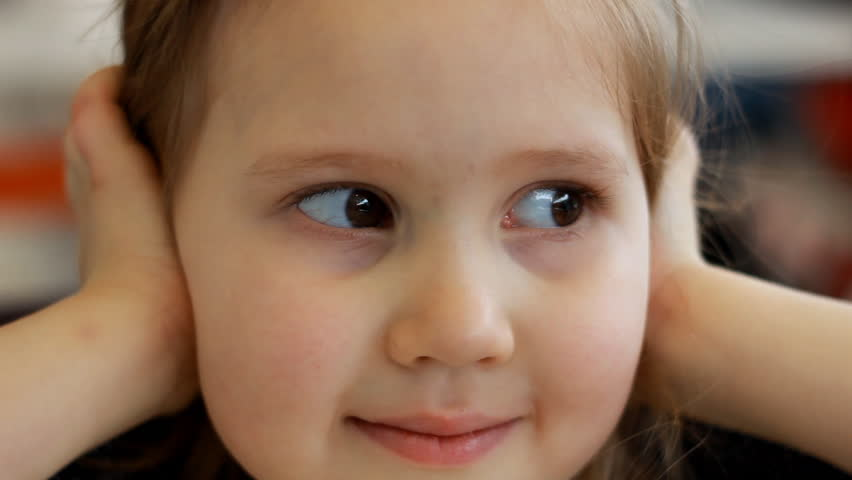 Portrait closeup of a child girl looking in the camera and smiling | Shutterstock HD Video #1026245882