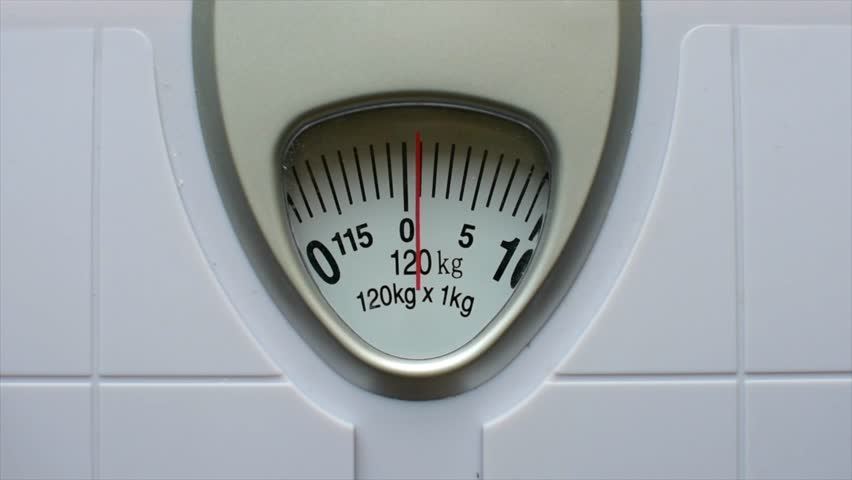 Close up body weight scales for measure weight loss.Weighing scale to healthy slimming concept. | Shutterstock HD Video #1026247709