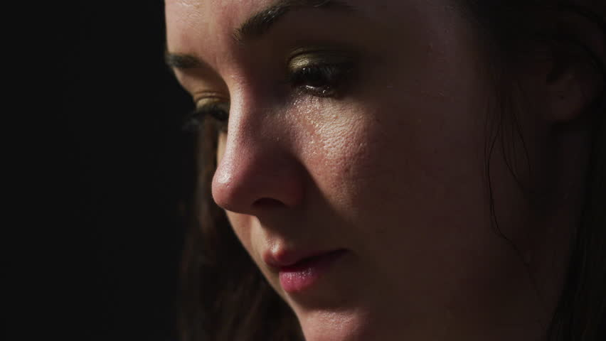 Close up of a sad woman crying | Shutterstock HD Video #1026252533