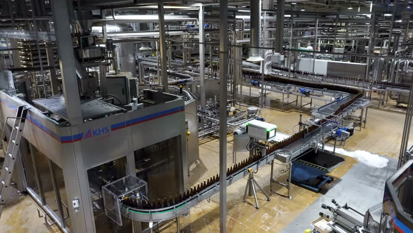 Moscow, Russian Federation – October 21, 2017: Beer factory interior with a lot of machines #1026253079