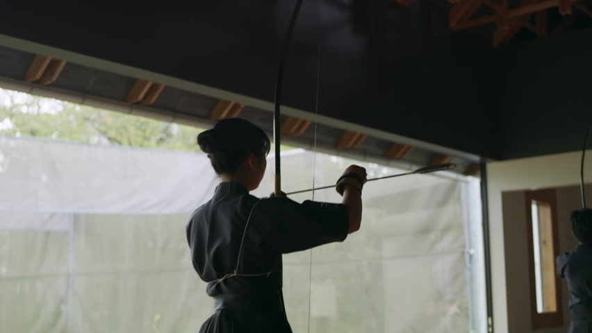 Japanese athletes practicing and training archery. Target practice. Shot on 4k RED camera.