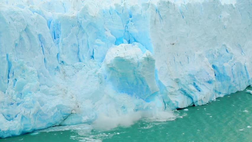 The Perito Moreno glacier in Los Glaciares National Park collapses into a large lake. | Shutterstock HD Video #1026286046