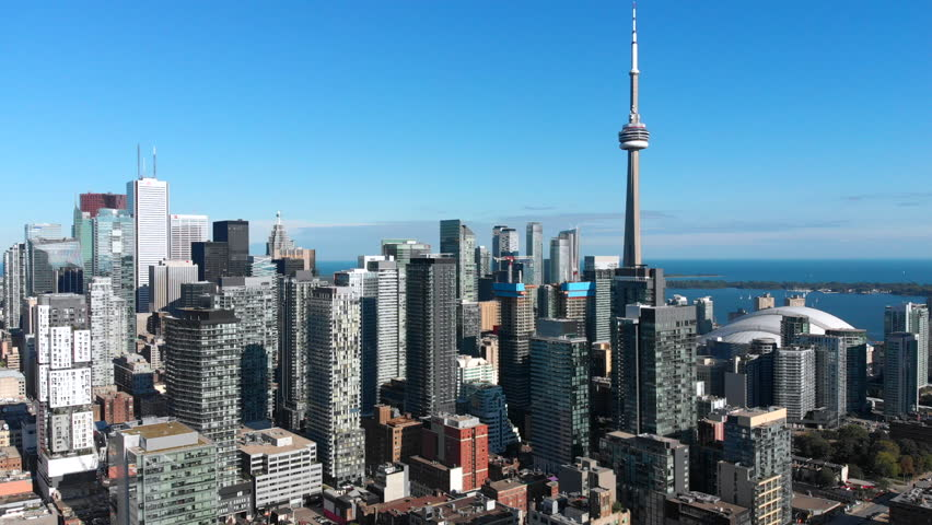Toronto, Canada, aerial view of office buildings and architectural landmark CN Tower in Downtown Toronto.